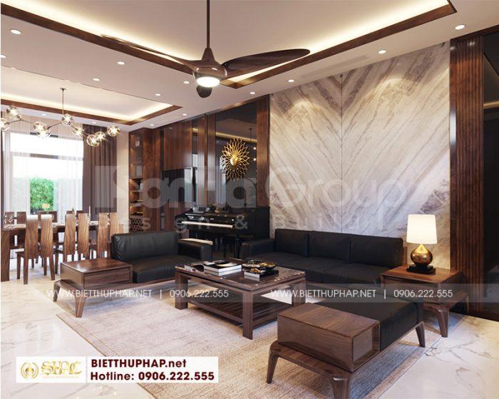 Căn phòng khách được bố trí ở trung tâm tầng 1 với vật liệu gỗ kết hợp nệm cao cấp tạo nên vẻ quyền quý cho ngô biệt thự